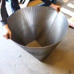A square to round steel fabrication