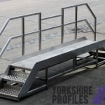 a stainless steel stairs fabrication with aluminium tread plate steps