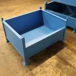 A steel stillage for workshop storage with a half side