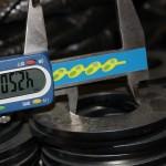 Digital callipers measuring laser cut holes