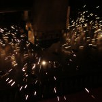 Laser cutter prepares to cut steel sheet metal